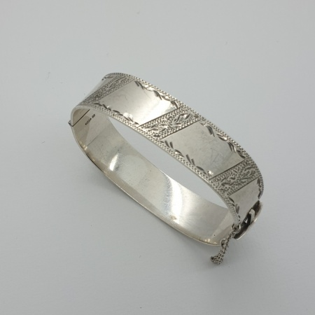 Silver Bangle with safety chain